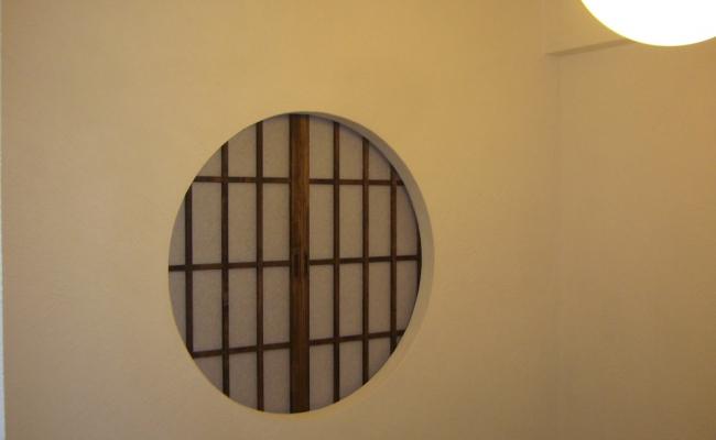 Shoji behind Round Wall Opening